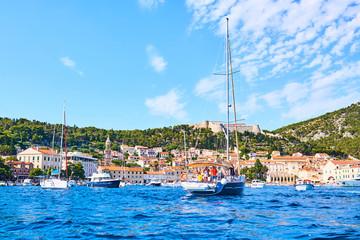 Luxury yachts, ships and fishing boats moored in harbor Hvar, Croatia
