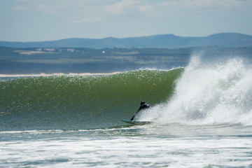 surfers at the famous jeffreys bay