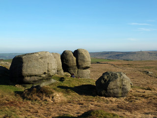 rock formations in bridestones moor in west yorkshire with a panoramic view over pennine countryside