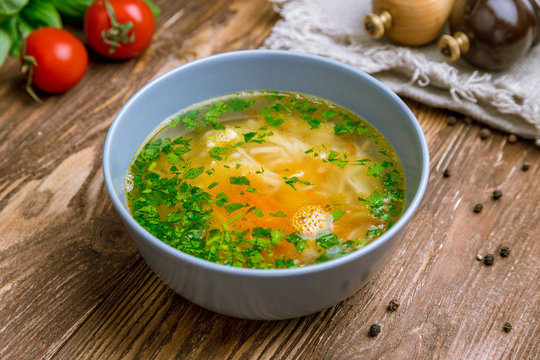 Chicken soup bouillon in a plate