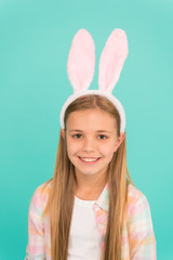 Happy childhood. Traditions for kids to help get in easter spirit. Bunny ears accessory. Easter activities. Cute bunny. Holiday bunny girl posing with cute long ears. Child smiling play bunny role