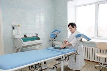 Gynecological office. Genicologist. Table for inspection of pregnant women. Maternity table.