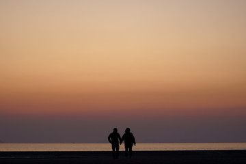 silhouette of a couple on the beach