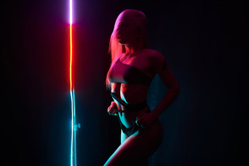 Pole dance girl with perfect body in black sexy lingerie. Night club concept Fototapete