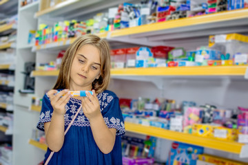 Child girl looking for products in store