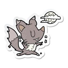 sticker of a cartoon werewolf changing in moonlight