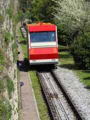 Bergamo, Italy. The red funicular in the old city of Bergamo is approaching the station at San Vigilio hill