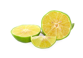whole and half with slice of fresh green lime isolated on white background