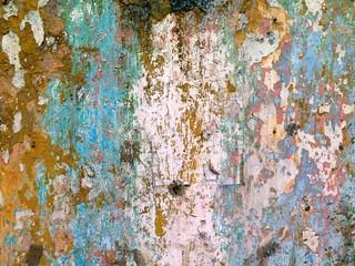 Vieux mur avec couches de peintures patinées et grattées. Texture rugueuse. Détails de la facade d'une maison à la Vieille Havane, Cuba.