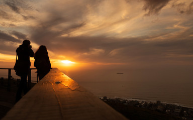 Tourist is taking a picture of sunset at view point . capetown . south africa