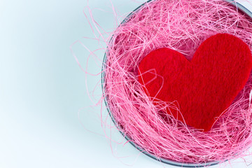 Felt red heart in a box with pink sisal