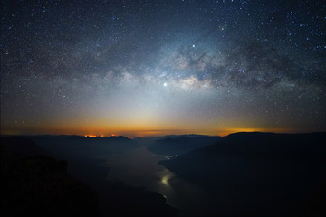 Landscape Milky Way rises over on mountain Pha Daeng Luang, Mae Ping National Park, Lamphun in Thailand.