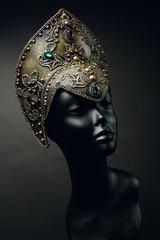 Mannequin head in creative Russian dark gold kokoshnick with jewels