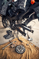 View of the back of a motorcycle with an emphasis on the chain.