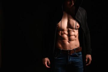 Fototapeta Muscular sexy bodybuilder on dark background obraz