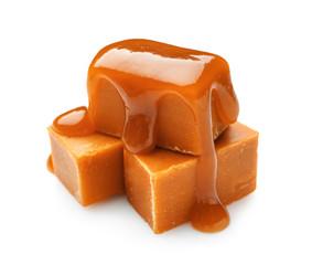 Tasty sweet caramel on white background
