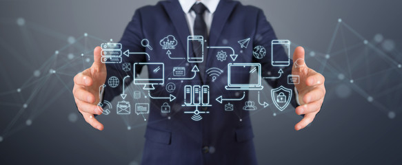 Businessman using tech devices and icons thin line interface