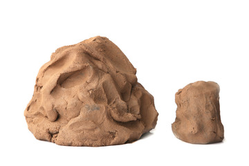Natural clay piece isolated on white background. Wet clay material for sculpting or modeling.