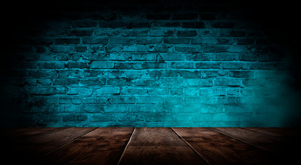 Dark empty room with brick walls and neon lights, smoke, rays. Brick wall, concrete and wooden...