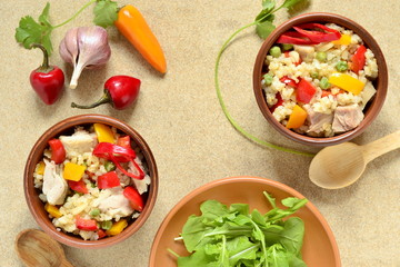 Rice with chicken and vegetables, top view, copy space