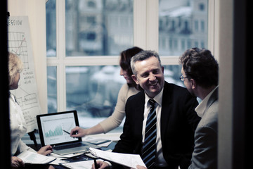 business partners engaged in dialogue in a modern office.