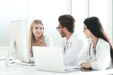 group of medical experts discussing online information.