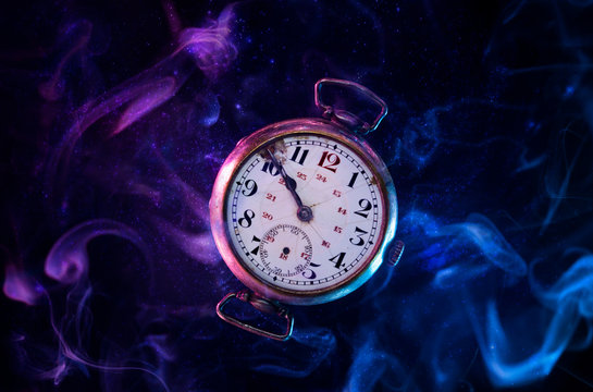 Conceptual photo of an old levitating pocket watch.