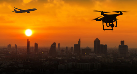 Silhouette of drone flying near an airport with airplane, no drone zone concept Wall mural