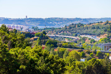 Panoramic view on Lisbon. Travel Portugal. Roads and bridges in big european city