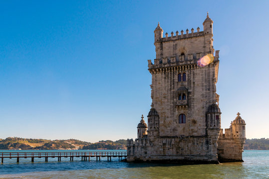 Scenic Belem Tower and wooden bridge miroring with low tides on Tagus River. Torre de Belem is Unesco Heritage and icon of Lisbon and the most visited attraction in Lisbon, Belem District, Portugal