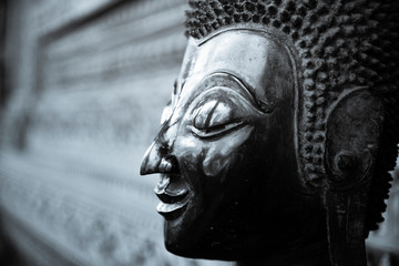 The Buddha face used as an amulet of Buddhism in Asia.