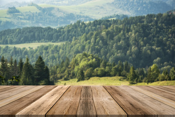 Wooden boards for product display or montage with rural landscape