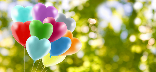 image of balloons on green background
