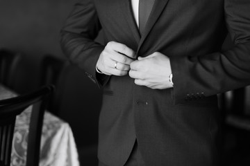the groom in a wedding suit, a man preparing for the wedding 1