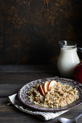 Buckwheat porridge with milk, apple, raisins and cashew nuts