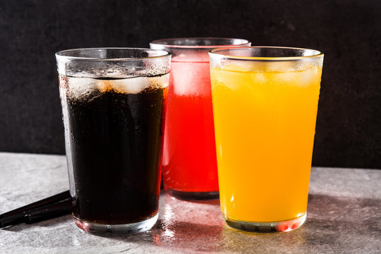 Colorful soft drinks for summer on gray background