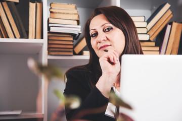happy business woman in office desk