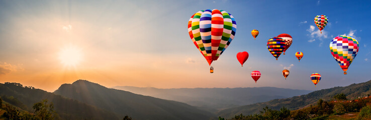 Poster de jardin Montgolfière / Dirigeable Colorful hot air balloon fly over mountain view 4