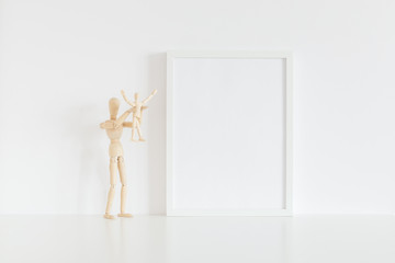Frame mock up and mannequin in child room.