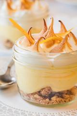 Lemon meringue tart served in a mason jar at a French restaurant.