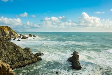 Waves crashing over the rocks on the California coast near San Francisco.