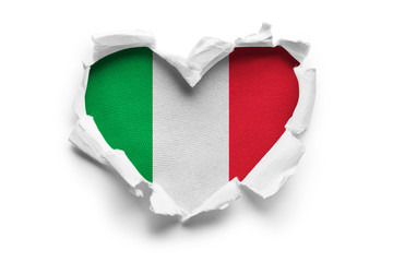 Heart shaped hole torn through paper, showing satin texture of flag of Italy. Isolated on white background Fotomurales