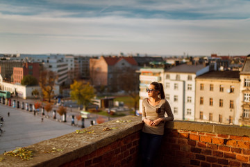 Woman in one of the castle towers with the beautiful view of the city Krakow, Poland