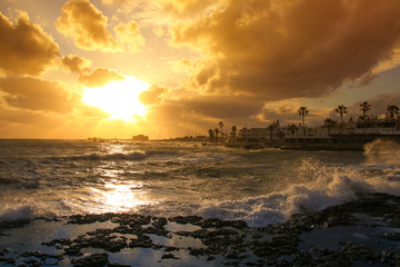 Sunset with view to Paphos Castle with big waves, Cyprus