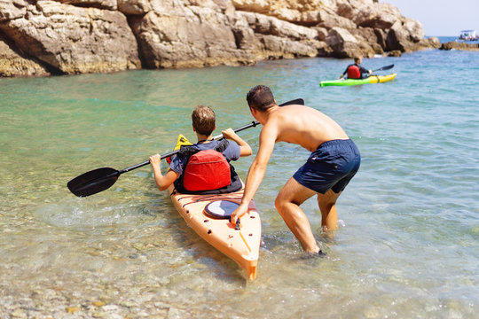 Kayaking and Canoeing School. Unidentifiable Professional instructor teaching a beginner