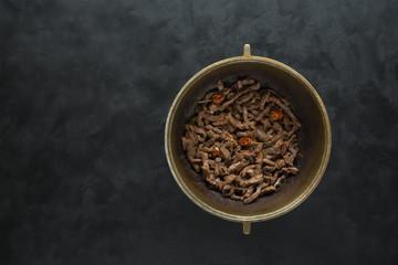 Fried beef in a cauldron. Beef stroganoff.