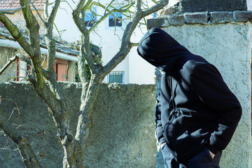 Stranger as robber or burglar or thief is spying around property with a plan to do illegal activity