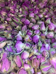 Traditional Iranian rose petal tea, dried pink rose buds, herbal infusion