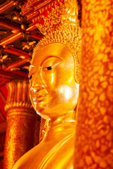 Ancient golden buddha statue at Wat Phumin, a famous buddhist temple in Nan Province, Thailand.