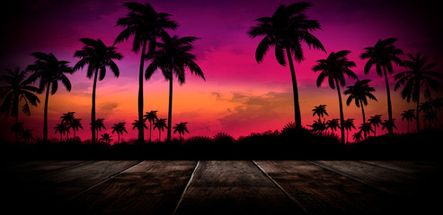 Empty stage with wooden table. Wooden table tropical leaves, palm trees. Night view of tropical leaves.